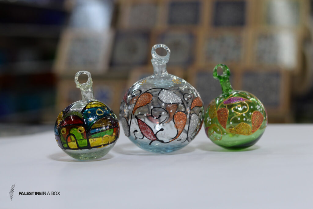 Glass blowing is a wide market in Hebron, and they are better known for these ornaments. Today, anyone looking for a handmade piece of Palestine can find even fragile Christmas ornaments ready to be shipped right from the source.