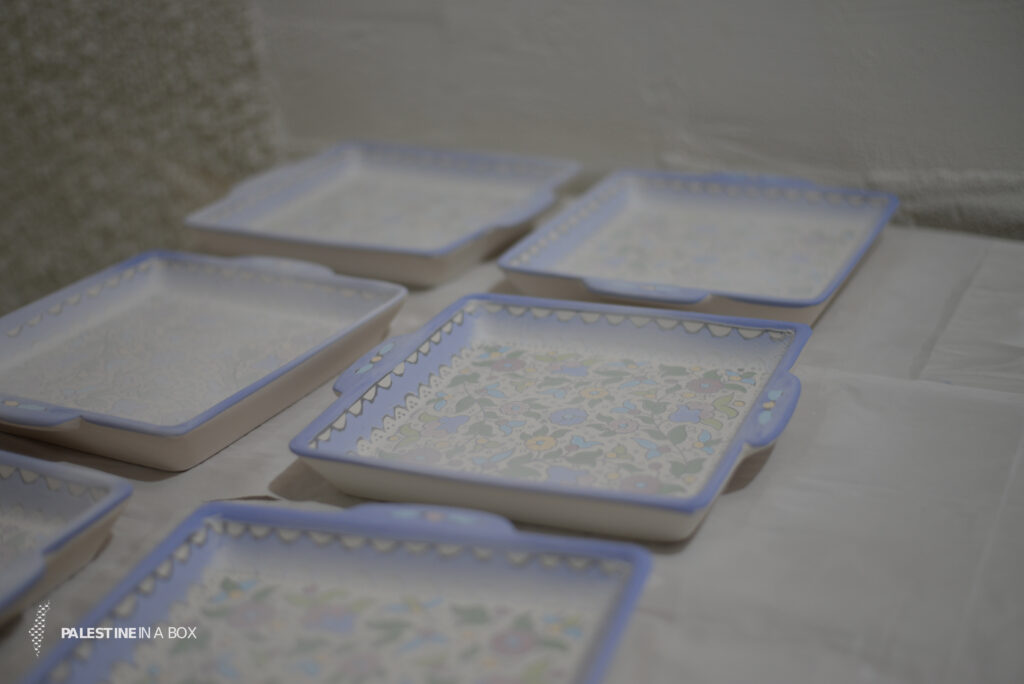 After each piece is carefully painted with beautiful arabesque scenery, many of which embody the many important symbols of Palestine, the pieces are put into the kiln to bake. After that, they are ready to be glazed.